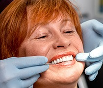 Older woman receiving dental exam