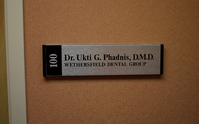 Dr. Utki Phadnis plaque on wall