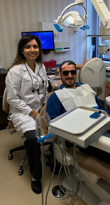 Dentist and dental patient in exam room