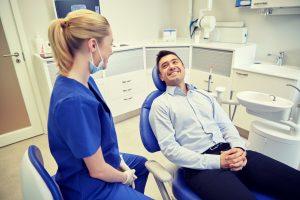 man at checkup with dentist