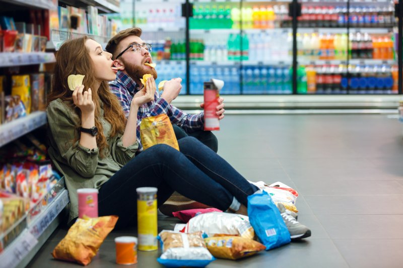 Couple enjoying snacks at the grocery store