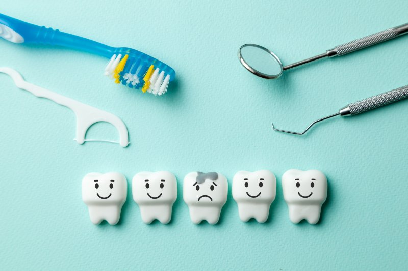 healthy white teeth and single tooth with cavity